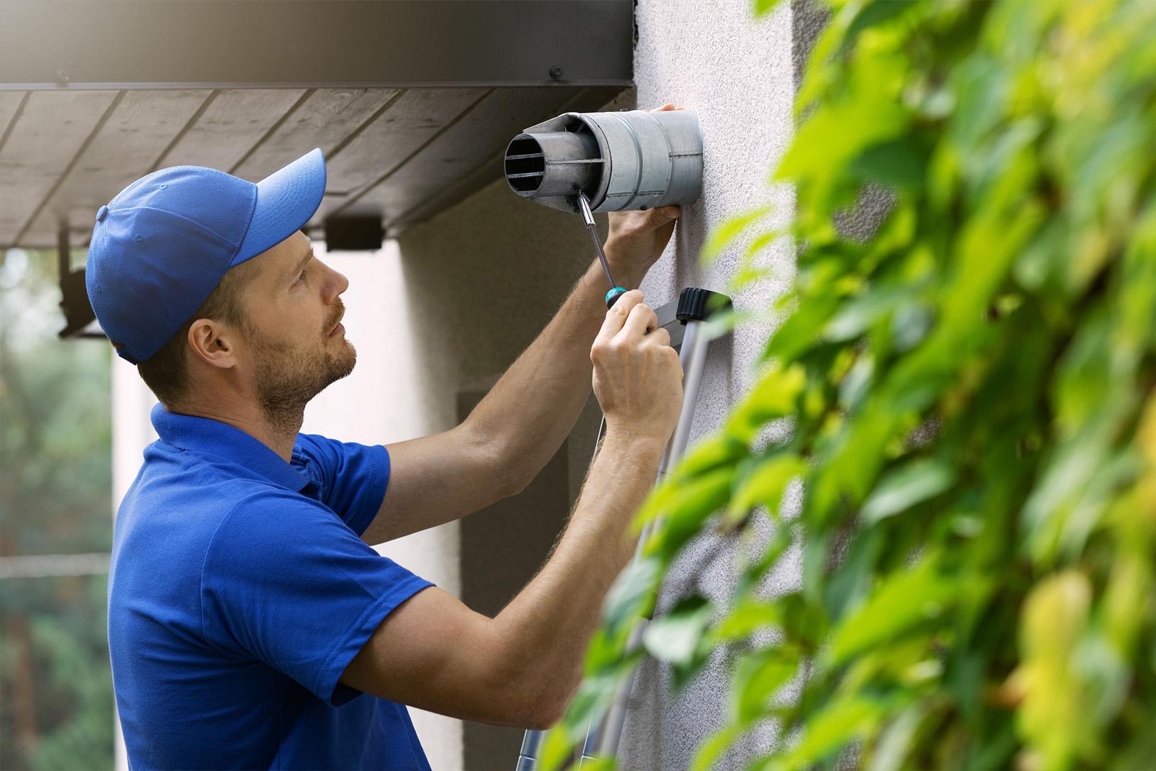 experienced engineers repairing boiler flue